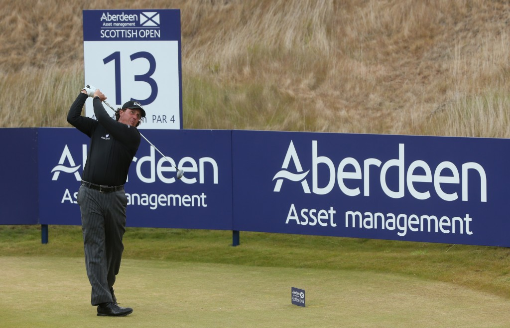 INVERNESS, SCOTLAND - JULY 14:  Phil Mickelson of the United States tees off on the 13th hole during the final round of the Aberdeen Asset Management Scottish Open at Castle Stuart Golf Links on July 14, 2013 in Inverness, Scotland.  (Photo by Andrew Redington/Getty Images)