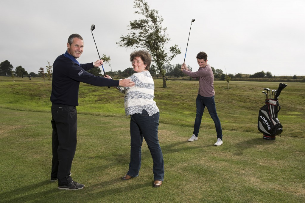 20150911- Get Into Golf at Monifieth Golf Links.  Monifieth golf pro Gordon McLeod  giving tips to Brigid Galea and Stuart Brodie.   Andy Thompson Photography for Angus Council.