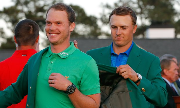 Danny Willett (ENG) receives the Green Jacket from Jordan Spieth (US)