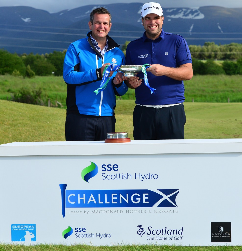 AVIEMORE, SCOTLAND - JUNE 28 : Jack Senior (R), of England winner of the 2015 SSE Scottish Hydro Challenge is presented with the trophy by Ruaridh MacDonald, Deputy Chief Executive MacDonald Hotels and Resorts at the MacDonald Spey Valley Championship Golf Course on June 28, 2015 in Aviemore, Scotland. (Photo by Mark Runnacles/Getty Images)