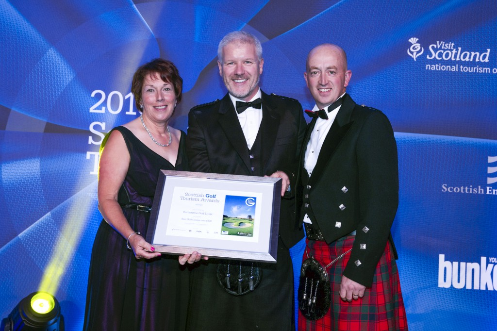 Pat Sawers, Chairman of the CGLMC (far left) and Sandy Reid, Links Superintendent at Carnoustie (far right) receive award from Bunkered magazine's Tom Lovering (centre). Pic Kenny Smith, Kenny Smith Photography Tel 07809 450119