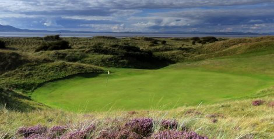 SILLOTH, CUMBRIA - AUGUST 25:  A view from behind the green on the 415 yards par 4, 7th hole 'Battery' at the Silloth on Solway Golf Club on August 25, 2010 Silloth, Cumbria, England.  (Photo by David Cannon/Getty Images)