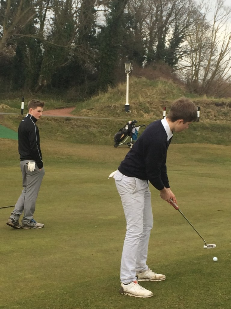 Alex Duckworth putts at 16 at Hesketh Golf Club watched by his Southport and Ainsdale club colleague Charlie Holland