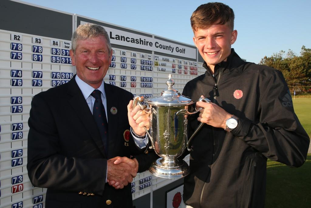 New Lancashire county golf champion Luke Kelly, from Ashton-under-Lyne Golf Club, receives the trophy from Mike Lay, Lancashire Union of Golf Clubs President. Picture: RAYMOND FARLEY