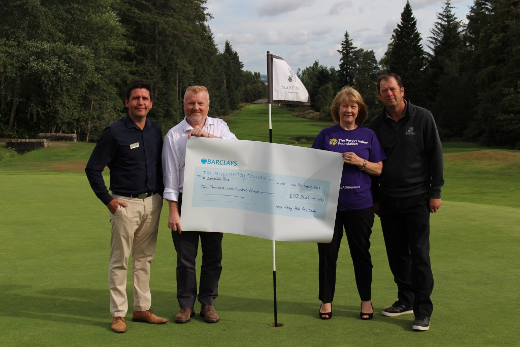 L-R Slaley Hall's Jonny Mould, Dr Fraser Quin from Dementia Care, Maria Hallett from The Percy Hedley Foundation and John Lee OBE, captain at Slaley Hall Golf club.