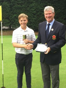 Sean Dobson (Royal Birkdale), the 2018 Lancashire Under 14 champion, receives the trophy from Michael Lay, President of the Lancashire Union of Golf Clubs