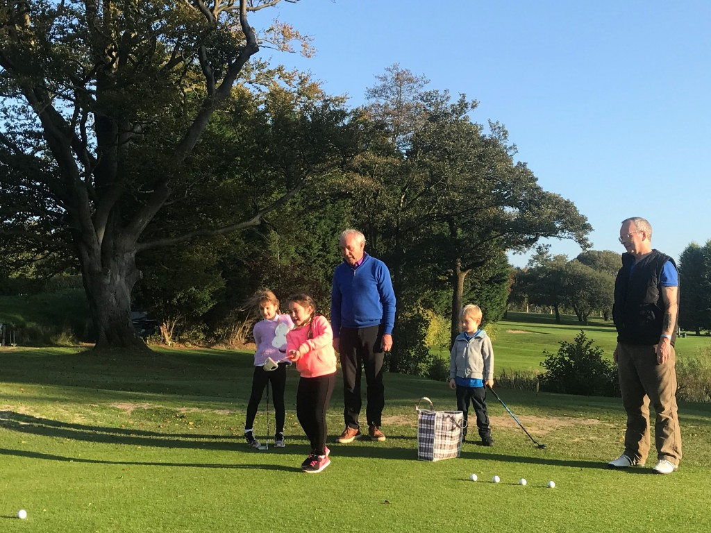 Youngsters at one of the weekly coaching sessions at Whalley Golf Club work on their short game.