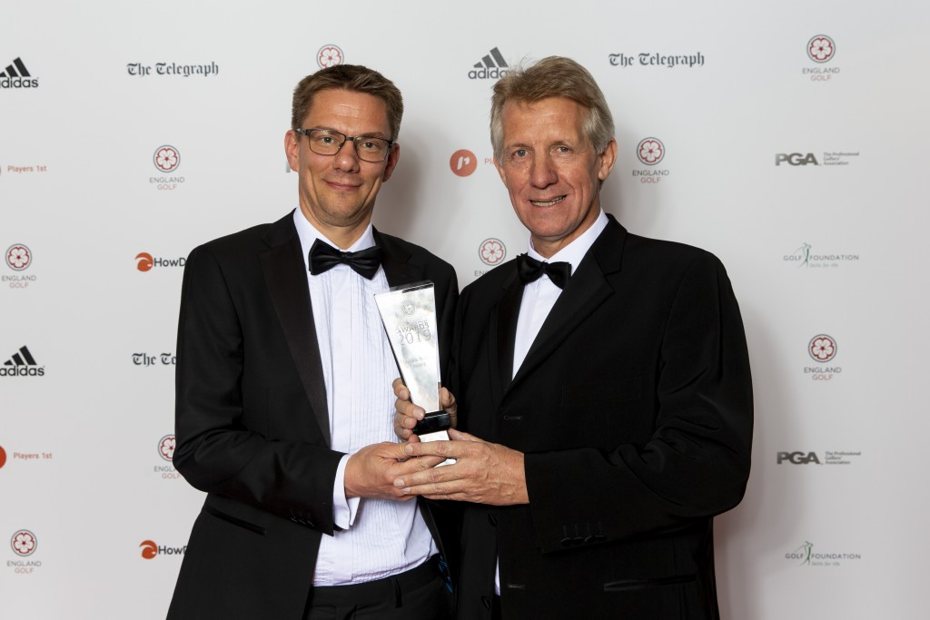 Ian Bonser receiving his Lifetime Achievement Award from Adam Sills, Head of Sport at The Telegraph.