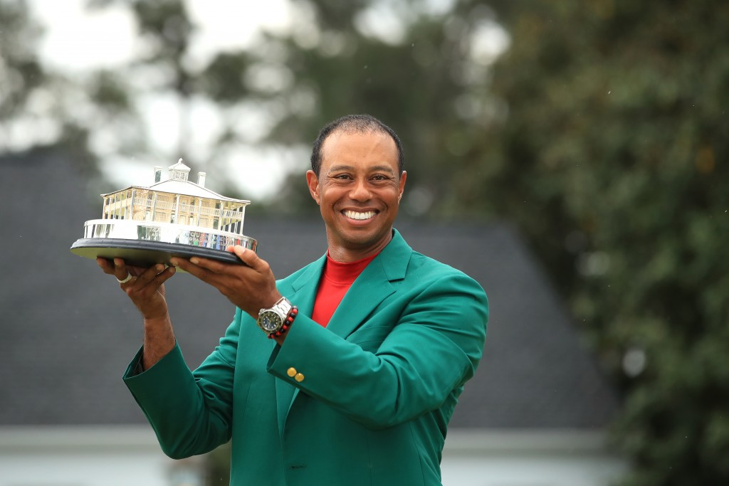 Tiger Woods holds the Masters Trophy after claiming his fifth Green Jacket at Augusta National. Picture by GETTY IMAGES