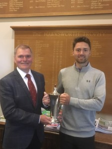 Bradford Captain Dr John Thompson presents the Hawksworth Trophy to 2019 winner Phil Tomkinson.