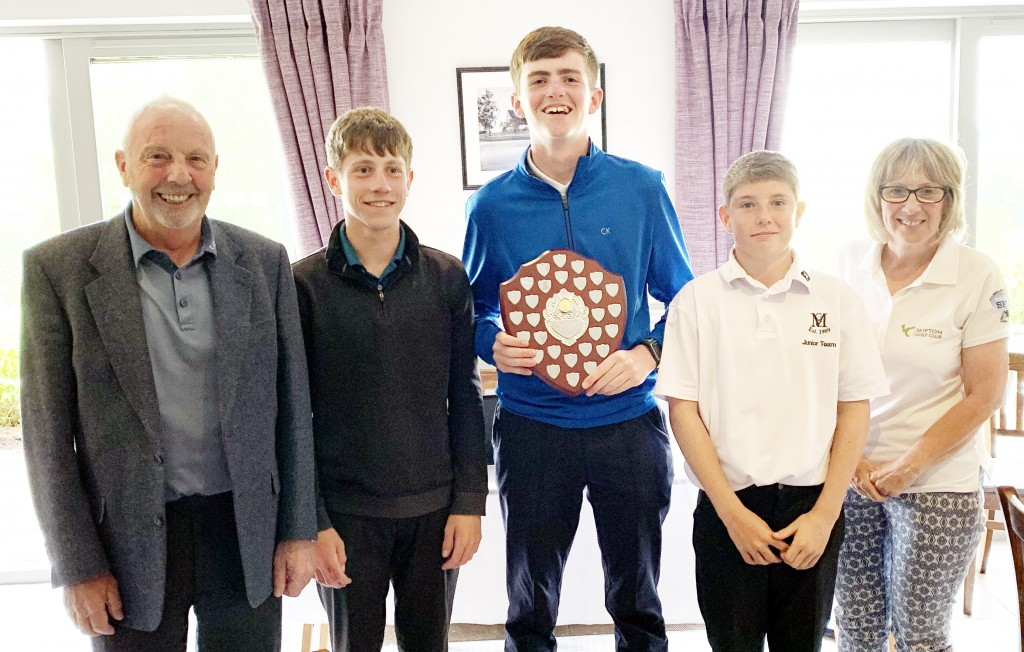 A group of the leading competitors at Skipton Golf Club's inaugural inter-schools tournament are joined by trophy presenters Jim Fox and Carolyn Murphy.