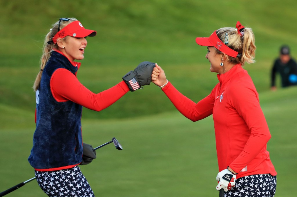 Thompson and Korda high five for Team USA on day one of the Solheim Cup at Gleneagles