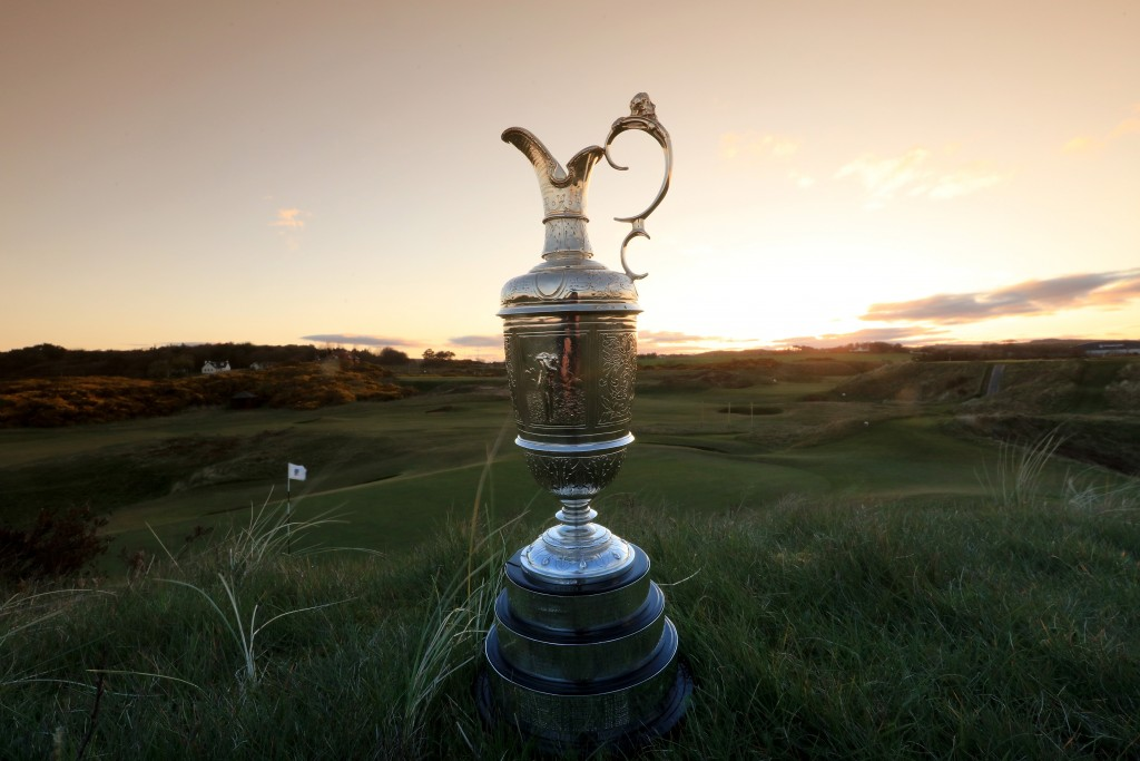 The Claret Jug sitting beside the green at Royal Troon's famous par three eighth hole – The Postage Stamp