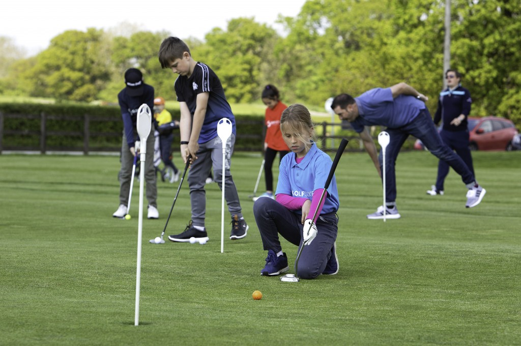 Youngsters practising before a GolfSixes League match