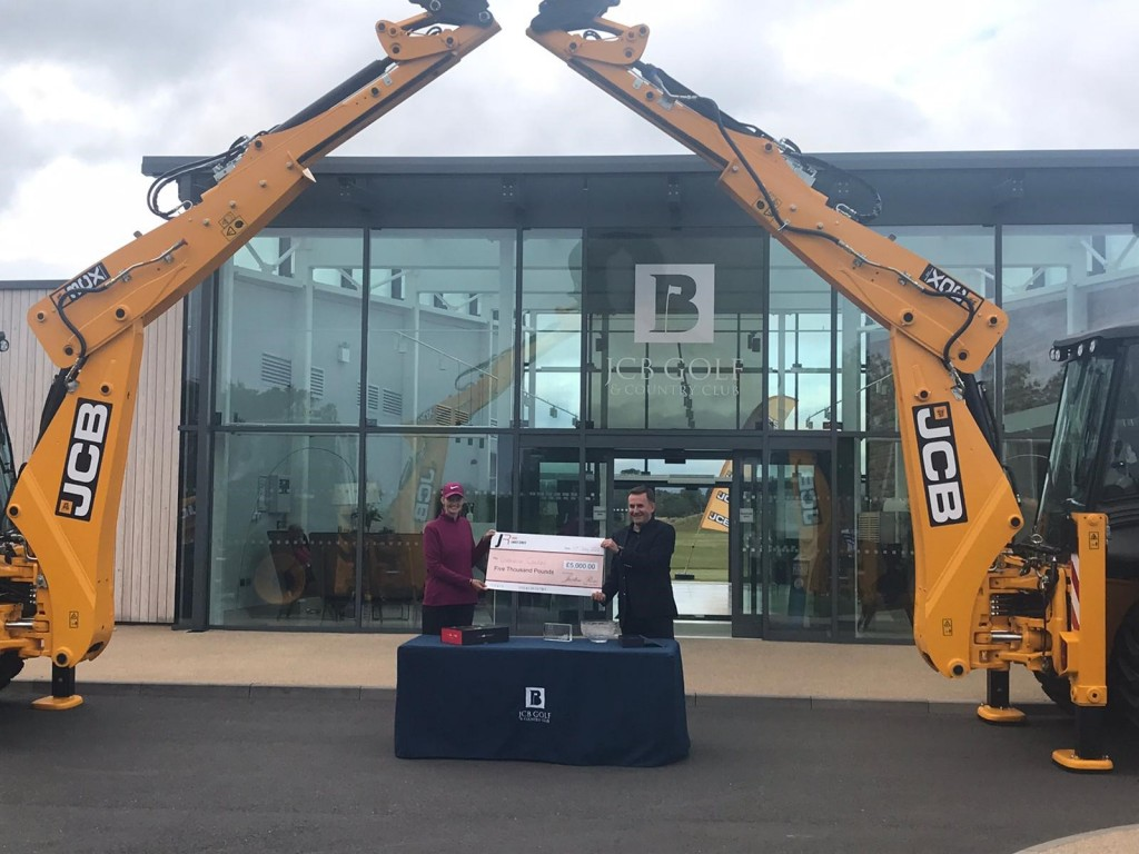 Gabriella Cowley receives her £5,000 winner's cheque after victory in the Rose Ladies Series at JCB Golf & Country Club