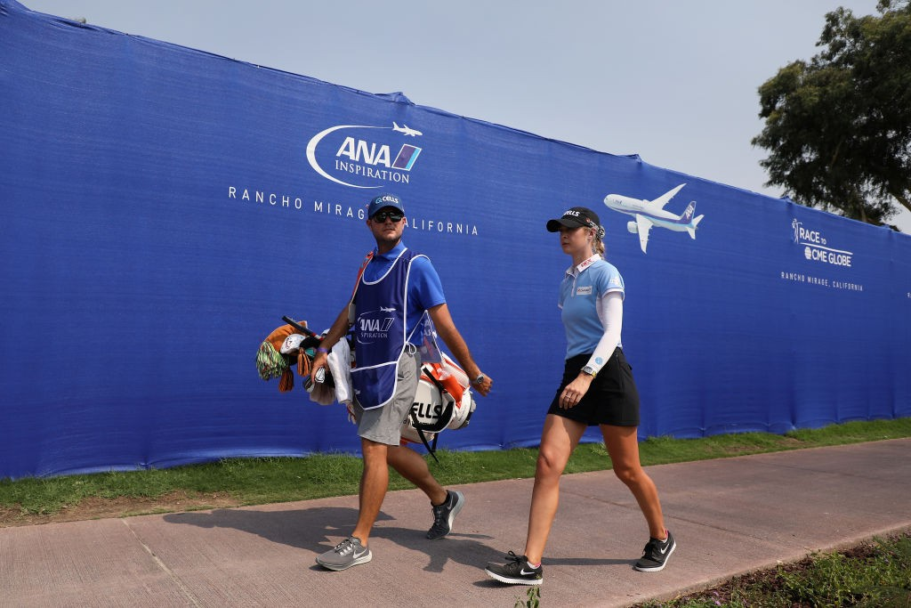 RANCHO MIRAGE, CALIFORNIA - SEPTEMBER 13: Nelly Korda and her caddie walk to the 18th green during the final round of the ANA Inspiration on the Dinah Shore course at Mission Hills Country Club on September 13, 2020 in Rancho Mirage, California. (Photo by Christian Petersen/Getty Images)